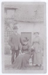 Oswald and Ann Cranwell with daughter Ivy (standing to the right)